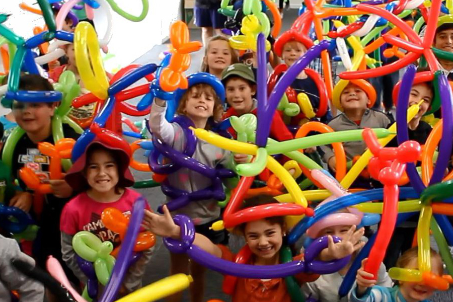 delighted children at a balloon twisting party by the Wow Factory