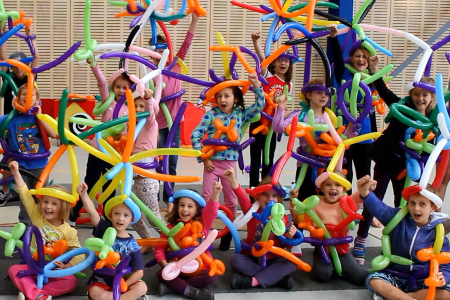 children at a balloon twisting party by the Wow Factory