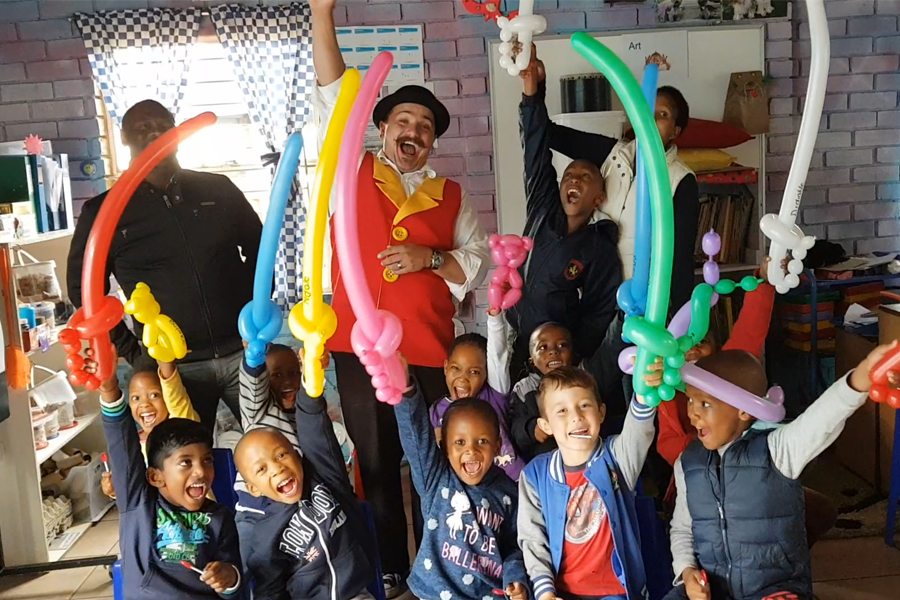 happy children with balloon models at a Wow Factory party with balloon twisting