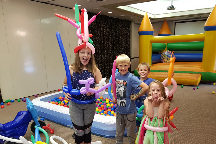 kids enjoying themselves at The Wow Factory balloon twisting party