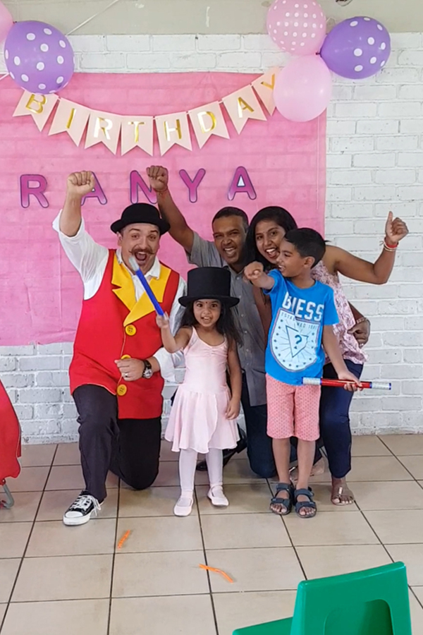 a happy family at the Wow Factory birthday party show